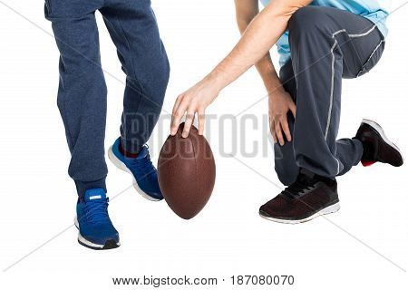 Cropped Shot Of Father With Child Playing Football Isolated On White