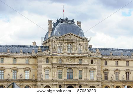 Paris France - May 1 2017: the Louvre buildings in the main courtyard (Cour Napoleon) of Louvre Museum on May 1 2017 in Paris France.