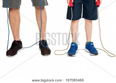 Partial View Of Father And Son With Skipping Ropes Isolated On White