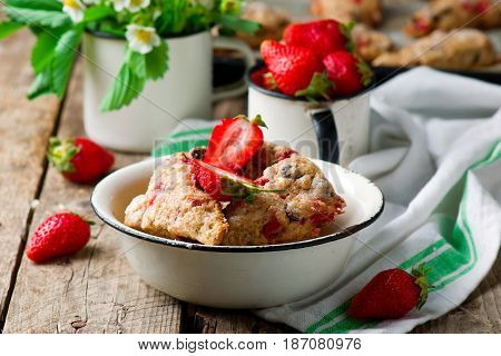 strawberry dark chocolate chunk wheat scones. style rustic.selective focus
