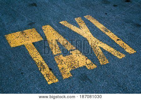 Taxi stand sign on asphalt parking lot