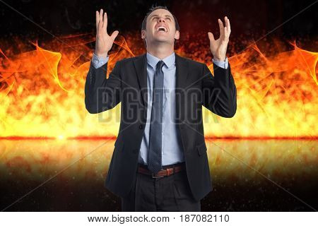 Digital composite of Digital composite image of angry businessman with fire in background
