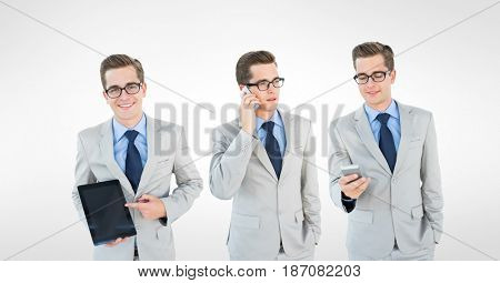 Digital composite of Multiple image of businessman with smart phone and tablet PC