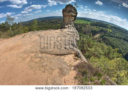 Capska cudgel - rock formation on a rocky promontory, Czech Republic