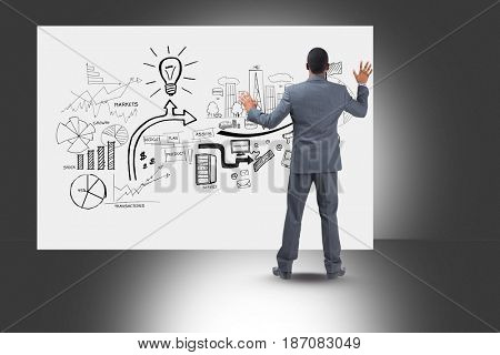 Digital composite of Rear view of professionals looking at diagrams on bill board