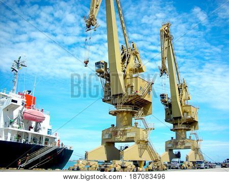 Double crane waiting to work at port.