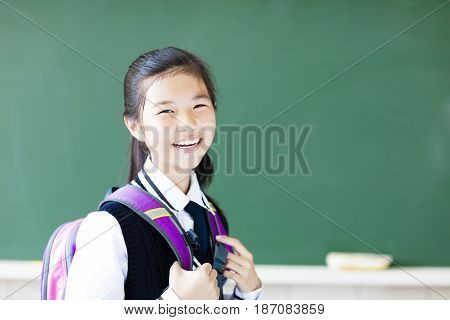 smiling asian  teenager student girl in classroom