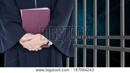 Digital composite of Midsection of judge with book against prison