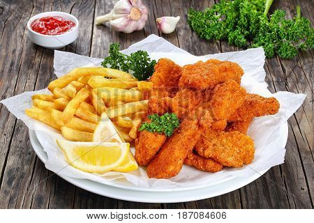 Delicious Crispy Chicken Nuggets With Fries