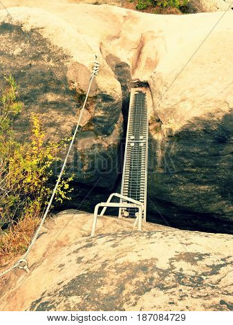 Steel Ladder Way, Steel Ramp Between Rocks Via Ferrata. Iron Twisted Rope Fixed In  Rock
