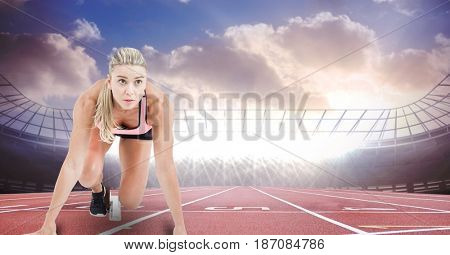 Digital composite of Sport runner at starting line in stadium