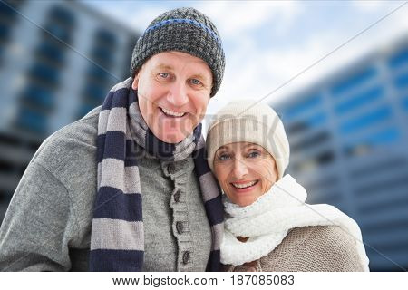 Digital composite of Portrait of happy senior couple in warm clothing
