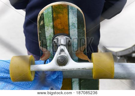 Skateboard detail and skater. Street urban background. Outdoor lifestyle