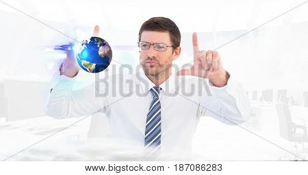 Digital composite of Digital composite image of businessman making hand frame while looking at globe