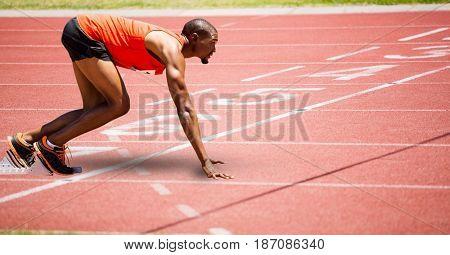 Digital composite of Full length of sport runner at start line