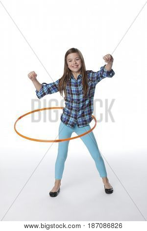 Caucasian girl twirling plastic hoop
