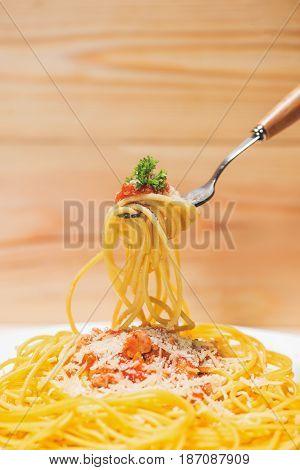 Close-up Of Asta Spaghetti With Tomato Sauce, Olives And Garnish. Italian Food.