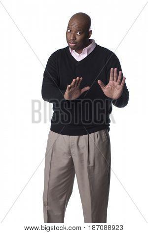Black man making refusing gesture