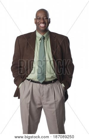 Smiling Black businessman with hands in pockets