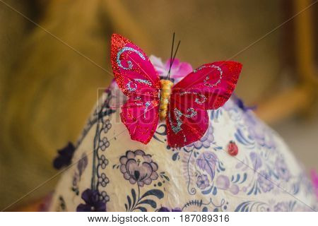 Grass with daisies and a self-sewn fabric Butterfly