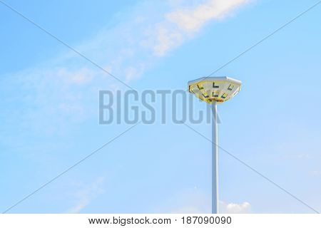Light pole in the blue sky background