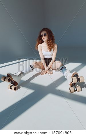 beautiful red hair hipster girl sitting on the floor hipster girl