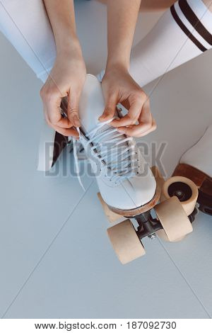 Close-up Partial View Of Hipster Girl Wearing Roller Skates Isolated On Grey