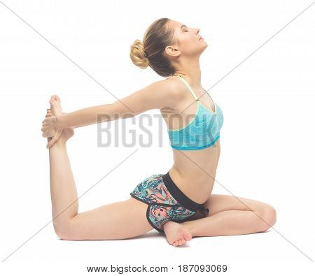 Sporty Beautiful Young Female Doing Yoga Pigeon Pose With One-hand Right Leg Grab / Ekohastapada Kap