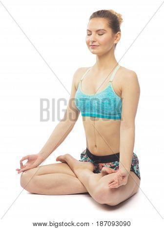 Sporty Beautiful Young Female Doing Yoga Lotus Pose / Padmasana. Isolated On White Background