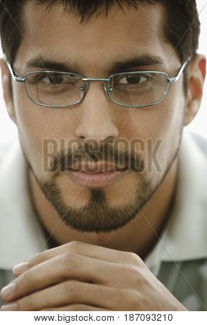 Close up of man with beard wearing eyeglasses
