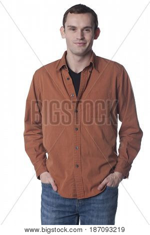 Smiling Caucasian man with hands in pockets