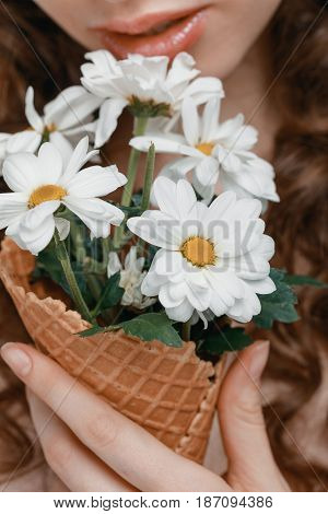 Partial View Of Woman Holding Flowers Bouquet In Ice Cream Cone
