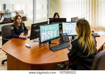 Uzhgorod Ukraine - May 5 2017: Police women process operational data during the opening of the modern situation center of the National Police of Ukraine in the Transcarpathian region.