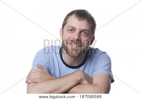 Smiling Caucasian man with arms crossed