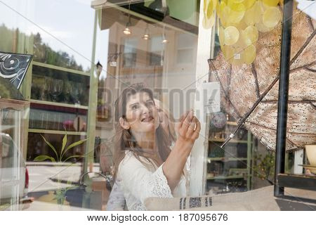 Caucasian woman checking price tag in store