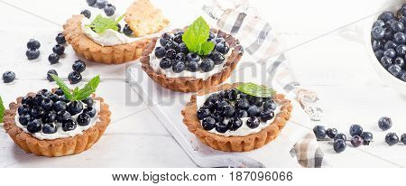 Blueberry Tarts On White Wooden Table