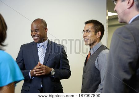 Business people talking together in office