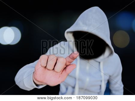 Digital composite of Anonymous Criminal Man in hood in front of city lights