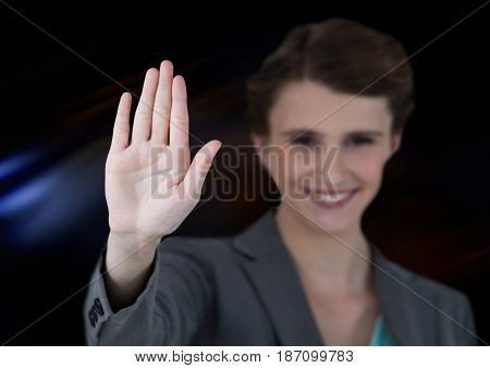 Digital composite of Woman waving with dark background