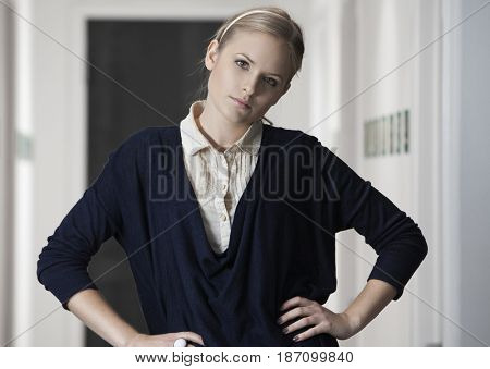 Caucasian businesswoman with hands on hips