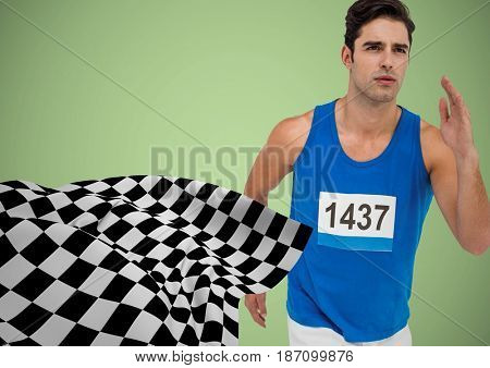 Digital composite of Male runner sprinting against green background and checkered flag