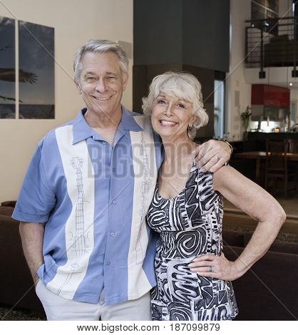 Smiling Caucasian couple standing together