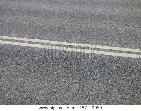 Gray asphalt highway with white layout. Blank surface with place for text. Abstract background, urban wallpaper.