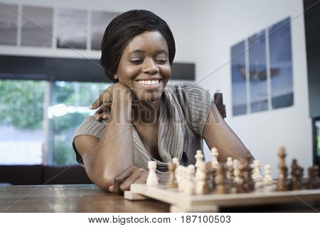 Black woman playing chess