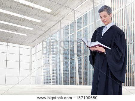 Digital composite of Judge holding book in front of large windows in city