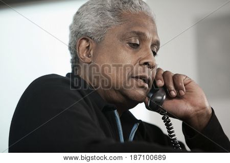 Black man talking on telephone
