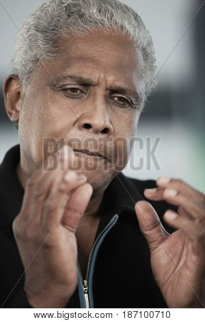 Black man talking and gesturing