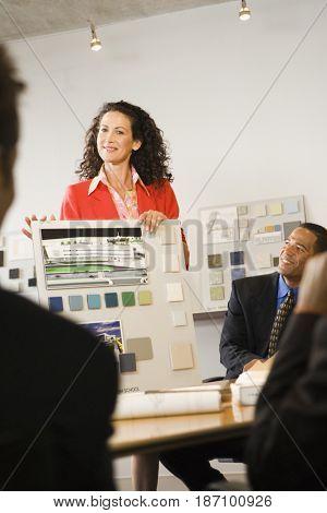 Caucasian interior designer giving presentation