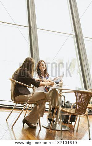 Hispanic businesswomen having lunch together