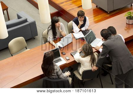 Hispanic business people having meeting in conference room